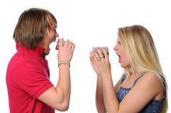 Couple Using Tin Can Phone to scream Royalty Free Stock Image