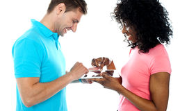 Couple using wireless touch pad device Stock Image