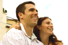 Couple V. A man and a woman looking ahead, smiling Stock Images