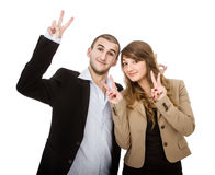Couple v for victory gesture Stock Photos