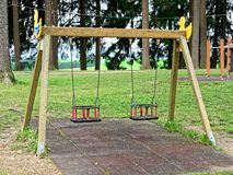 Couple of vacant swings playground. Couple of vacant swings at playground Stock Photo