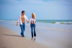 Couple on vacation on a beach Royalty Free Stock Photo