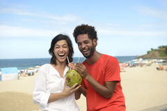 Couple on vacation drinking coconut water Royalty Free Stock Photo