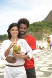 Couple on vacation drinking coconut water stock photography