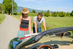 a couple, on vacation, look at a map, Stock Image