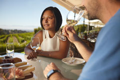 Couple on vacation in outdoor wine bar restaurant. Royalty Free Stock Image