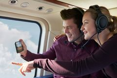 Couple On Vacation Taking Ride In Helicopter Royalty Free Stock Photo