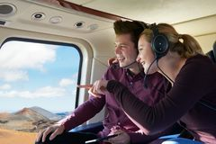 Couple On Vacation Taking Ride In Helicopter. Together stock photos
