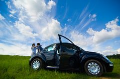 Couple Vacationing. A couple on a road trip playing in a field Royalty Free Stock Photography