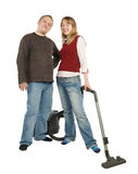 Couple with vacuum cleaner Royalty Free Stock Photos
