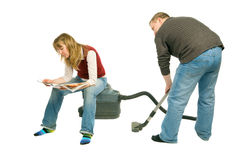 Couple With Vacuum-Cleaner stock photos