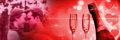 Couple with valentine`s love transition champagne glasses. Digital composite of Couple with valentine`s love transition champagne glasses royalty free stock image