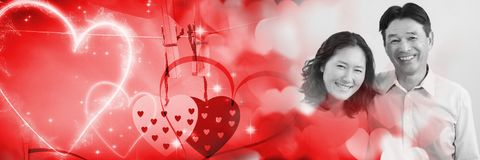 Couple with valentine's love transition hearts. Digital composite of Couple with valentine's love transition hearts Stock Images