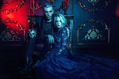 Couple of vampires together. A beautiful couple of vampires is in a dark room. Classic style. Beauty, fashion stock images