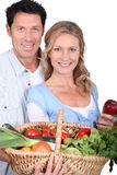 Couple with vegetable basket. Royalty Free Stock Photography