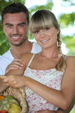 Couple with vegetable basket Stock Photography