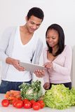 Couple With Vegetables And Digital Tablet Royalty Free Stock Photos