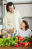 Couple with vegetables in the kitchen Stock Photo