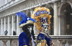 The couple of Venetian costumes in Piazza San Marco in Venice Stock Image