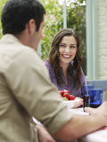 Couple At Verandah Table Royalty Free Stock Photo