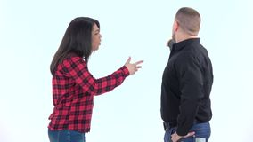 Couple very emotional quarrel isolated on white background. Slow motion. Brunette woman in a plaid shirt, a man with a beard in a black shirt very emotional stock video
