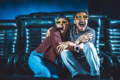 Guy and girl 3d glasses are very worried while watching a movie stock images