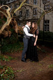 Couple in Victorian clothing embracing in the park Stock Images
