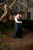Couple in Victorian clothing embracing in the park Stock Image