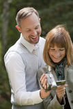 Couple with video camera Royalty Free Stock Photography