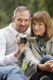 Couple with video camera Stock Images
