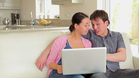 Couple on video chat on laptop. On sofa stock footage