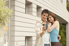 Couple Videoing in Home Garden Royalty Free Stock Images