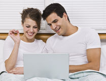 Couple Viewing Laptop Stock Photos