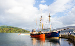 Couple of vintage boats docked at Inveraray harbour, Scotland Royalty Free Stock Photo