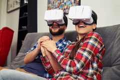 Couple in virtual reality glasses watching romantic movie Stock Photography