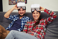 Couple with virtual reality headset glasses on top of they heads Royalty Free Stock Photos