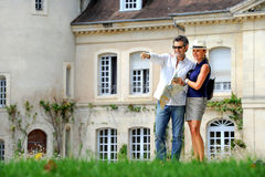 Couple visiting a castle in the Bordeaux vineyard stock image