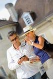 Couple visiting a castle in the Bordeaux vineyard Stock Photos