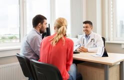 Free Couple Visiting Doctor At Family Planning Clinic Stock Photos - 102496493