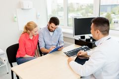 Free Couple Visiting Doctor At Family Planning Clinic Stock Photo - 103611190