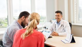 Couple visiting doctor at family planning clinic royalty free stock photos