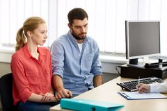 Couple visiting doctor at family planning clinic Stock Photography