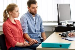 Couple visiting doctor at family planning clinic Stock Photos