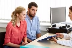 Couple visiting doctor at family planning clinic Stock Image