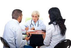 Free Couple Visiting Doctor In Office Stock Photos - 16480773