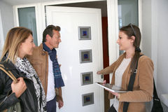 Couple visiting new house with realtor Stock Images