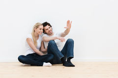 Couple visualising the decor of their new home Stock Photo