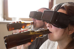 Couple with vr glasses and beer Royalty Free Stock Photos