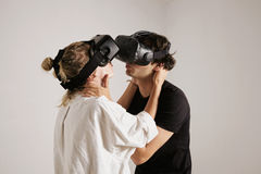 Couple in VR glasses kissing Stock Photography