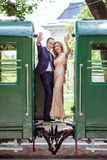 A couple between by wagons Royalty Free Stock Photography